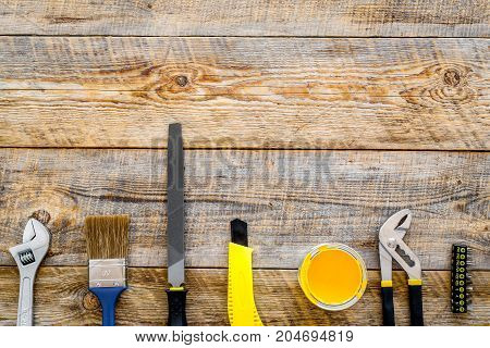 building, painting and repair tools frame for house constructor work place set on wooden background top view space for text