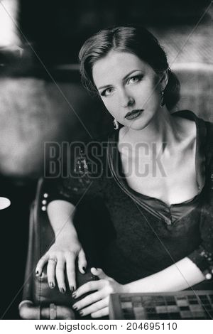 beautiful young woman in retro style indoors. black and white