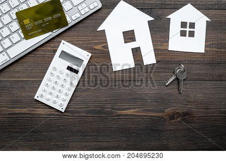 buy house online set with paper figures and keys on office desk wooden background top view mock-up