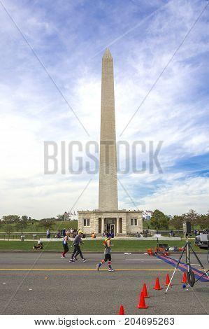 Washington D.C USA, october 30 2016: Runners compete in the Marine Corps Marathon under the George Washington Monument in Washington D.C