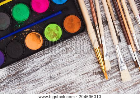 Set Of Watercolors And Different Paintbrushes