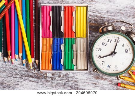 Different School Supplies On The Light Wooden Background