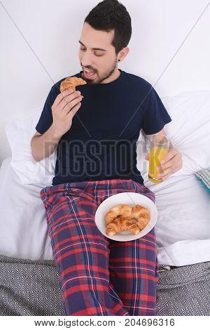 Man Having Breakfast In Bed.