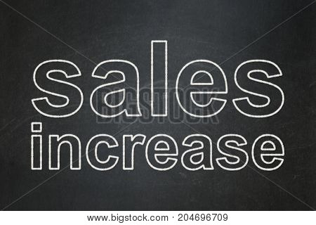 Advertising concept: text Sales Increase on Black chalkboard background