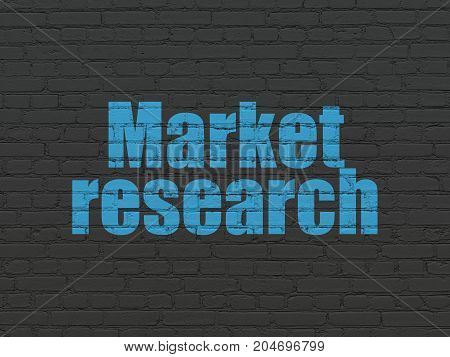 Advertising concept: Painted blue text Market Research on Black Brick wall background