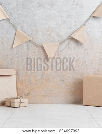 Background With Garland Of Small Paper Flags And Gift Boxes