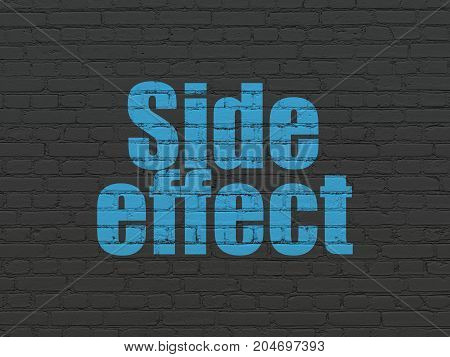Healthcare concept: Painted blue text Side Effect on Black Brick wall background