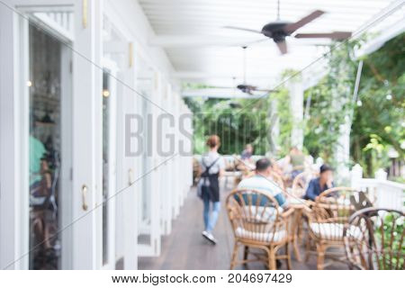 Blurred background - Coffee shop in building blur background with bokeh. Vintage filtered image