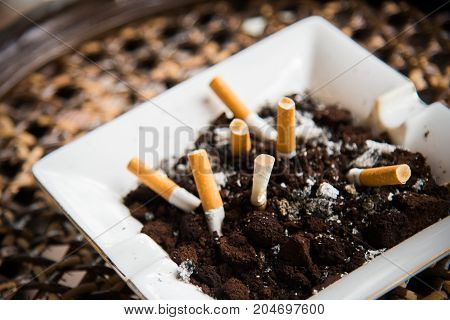 Cigarette In An Ashtray.cigarette Butts On And.smoking Cigarette Stub In Bucket Sand.