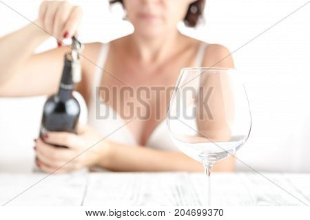 Woman In White Lingery Pourung Red Wine In Glass
