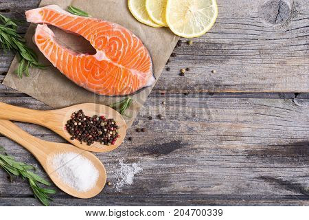 Ingredient for preparation salmon fish steak with lemon pepper and salt