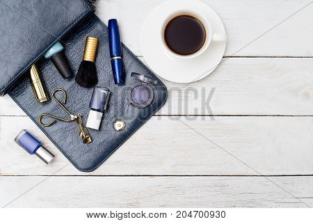 Feminine accessories on wooden background. Copy space