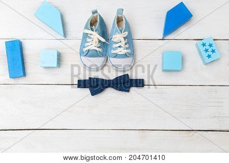 Blue sneakers and a bow tie for a boy. View from above