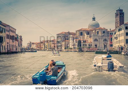 Venice, Italy - May 18, 2017: Motor boats are sailing along the Grand Canal. Motor boats are the main transport in Venice.