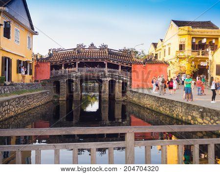 HOIAN, VIETNAM, SEPTEMBER, 04 2017: Unidentified people walking in a covered bridge Cau Chua Pagoda, Cau Nhat Ban, Lai Vien Kieu, Hoi An Ancient Town Hoian in Vietnam.