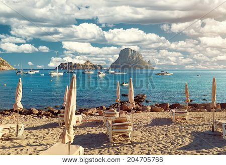 Cala d'Hort beach. Cala d'Hort in summer is extremely popular beach have a fantastic view of the mysterious island of Es Vedra. Ibiza Island Balearic Islands. Spain