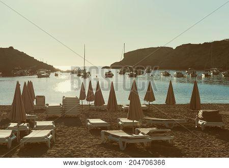 Empty deckchairs on the Cala Vadella beach in Ibiza Island. Balearic Islands. Spain