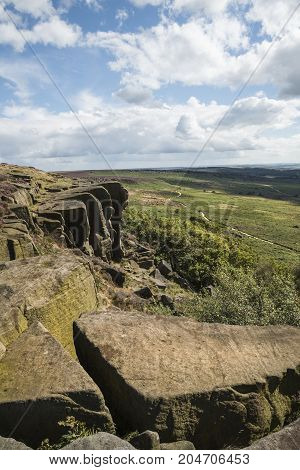 Beautiful Vibrant Landscape Image Of Burbage Edge And Rocks In Summer In Peak District England