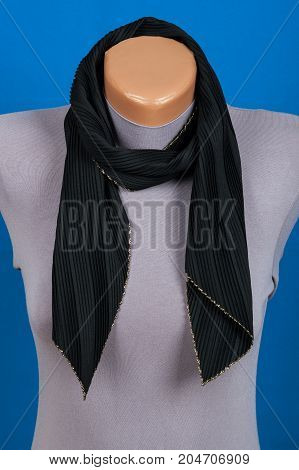 Black Scarf On Mannequin Isolated On Blue Background.