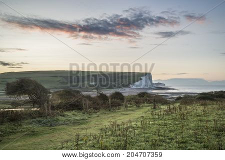Beautiful Dawn Landscape Of Seven Sisters Cliffs Landmark On English Coast