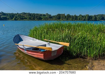 Life guard boat at the coast of the Rusalka lake on a sunny day on August 2017 in Poznan Poland