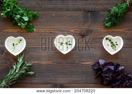 greenery with natural oil for home food cooking on wooden kitchen table background top view