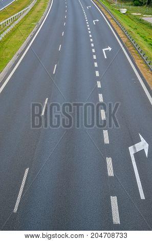 Grey asphalt road. A4 motorway in Poland.