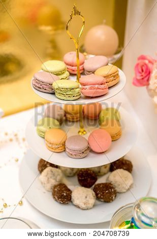 French Colorful Macaroons On Cake Stand. Birthday Party. Holiday Candy Bar, Free Space. Table With S