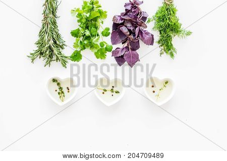 home cooking with fresh greenery and organic oil on white kitchen table background top view mock up