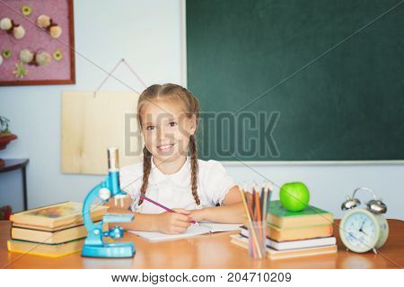 Little Cute Girl Study With Microscope In Classroom