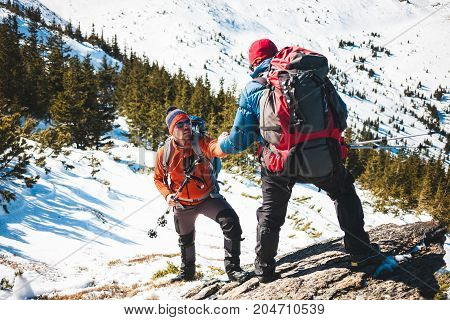 Two Climbers In The Mountains.
