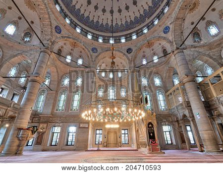 Istanbul, Turkey - April 24, 2017: Interior low angle shot of Eyup Sultan Mosque situated in the Eyup district of Istanbul Turkey outside the city walls near the Golden Horn. The present building dates from the beginning of the 19th century