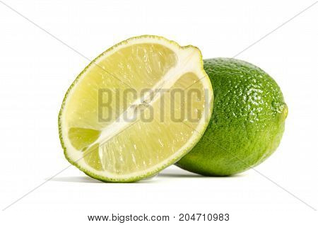 Lime With Half Of A Juicy Lime Isolated On White Background