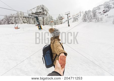 Woman Hold Man Hand Romantic Couple Snow Forest Outdoor. Winter time.