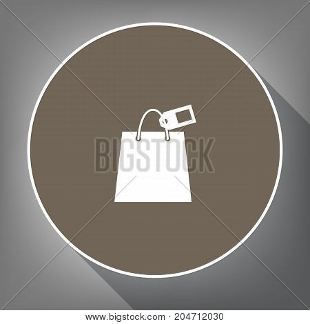 Shopping bag sign with tag. Vector. White icon on brown circle with white contour and long shadow at gray background. Like top view on postament.