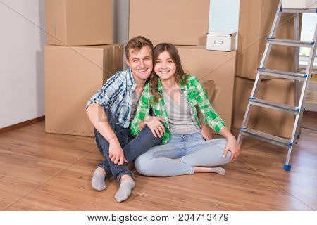 Home, people, moving and real estate concept - Portrait of happy couple in new home.