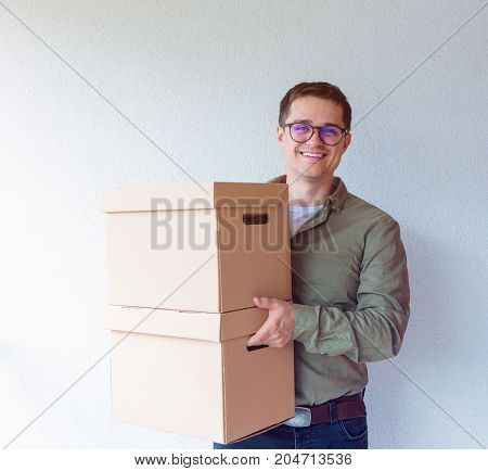 Handsome Man With Moving Boxes On White Background