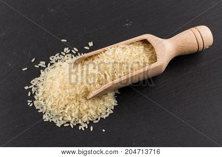 Scoop of rice on puffed rice cereal background close up