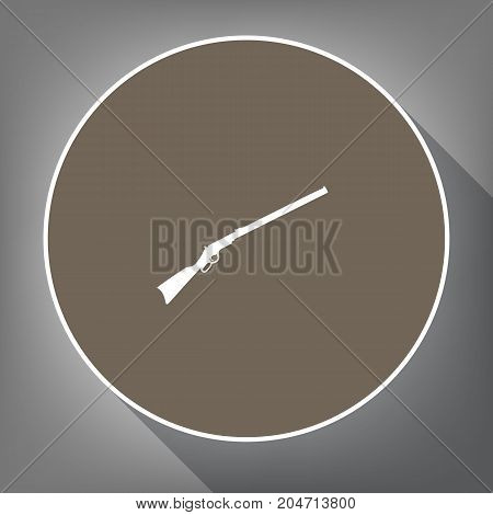 Hunting rifle icon vector illustration. Silhouette gun. Vector. White icon on brown circle with white contour and long shadow at gray background. Like top view on postament.