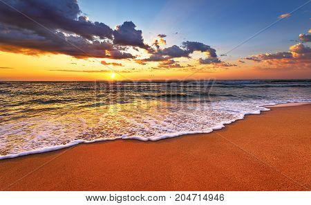 Beautiful tropical sunrise on the beach. Golden sands.