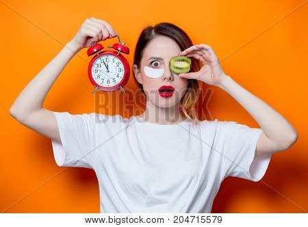 Woman Using Eye Patch For Her Eyes On Orange Background Isolated.