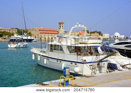 RHODES, GREECE- AUGUST 2017: Yachts at seaport of Rhodes town on Rhodes idland, Greece