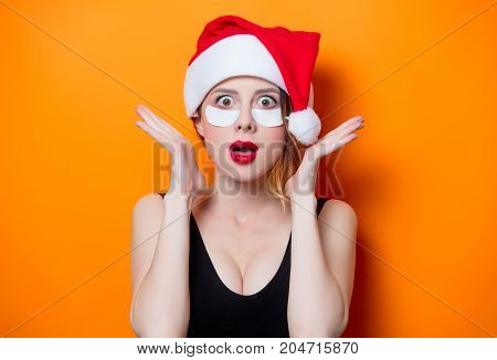 Woman Using Eye Patch For Her Eyes In Santa Claus Hat