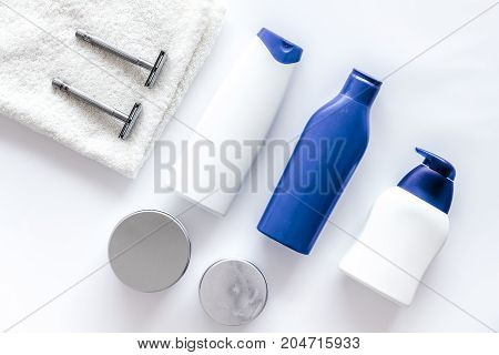 Shampoo and shower gel for men on white background top view.