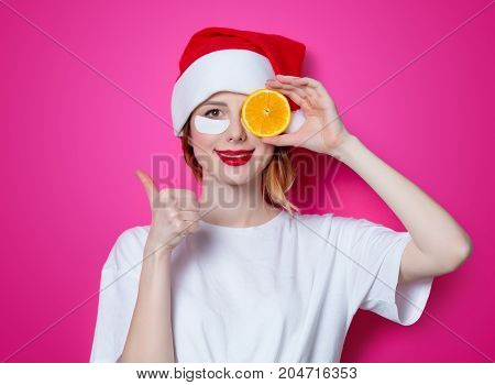Woman Using Eye Patch For Her Eyes And Holding Orange