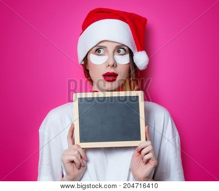 Woman Using Eye Patch For Her Eyes And Holding Blackboard