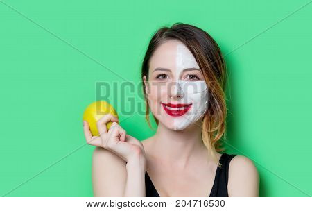 Woman Using Eye Patch For Her Eyes And Mask With Apple
