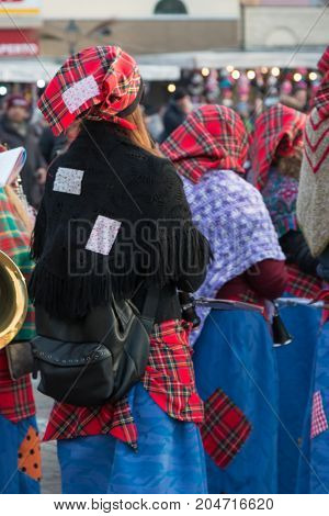 Parma, Italy - january 2015: Group of Women with Red Scottish Kerchief and Shawles in Public Ground