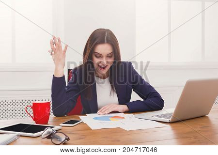 Deadline stress concept. Angry business woman at workplace in office after hard working day, checking document