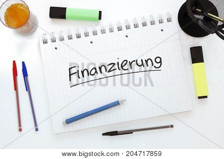Finanzierung - german word for funding or financing - handwritten text in a notebook on a desk - 3d render illustration.